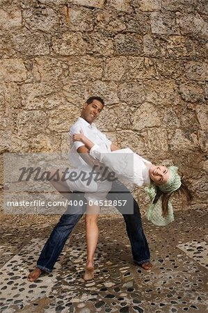 Portrait of beautiful couple posing in stone background Stock Photo - Budget Royalty-Free, Image code: 400-04512857