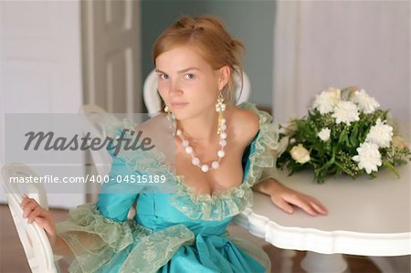 Aristocratic girl in fancy dress by the table with bouquet of roses - right before ball Stock Photo - Budget Royalty-Free, Image code: 400-04515189