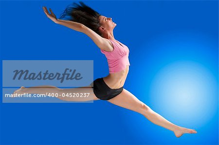 a cute gymnast in a hard jump on a blue background Stock Photo - Budget Royalty-Free, Image code: 400-04520237