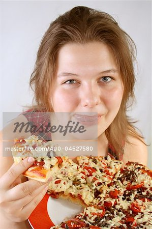 Beautiful no make-up girl eating a piece of Pizza Stock Photo - Budget Royalty-Free, Image code: 400-04527580