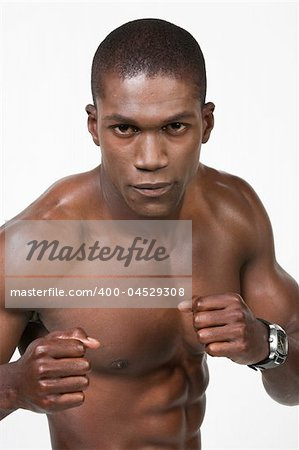 African American Athlete shows some muscle Stock Photo - Budget Royalty-Free, Image code: 400-04529308