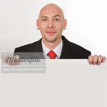 Photo of smiling male behind partition looking at camera Stock Photo - Budget Royalty-Free, Image code: 400-04540207