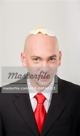 Portrait of smiling male with omelet on top of bald head Stock Photo - Budget Royalty-Free, Image code: 400-04540213