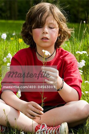 young boy is looking to his flower Stock Photo - Budget Royalty-Free, Image code: 400-04563009