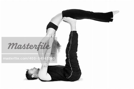 Male and female gymnasts practicing a complex double yoga pose. Stock Photo - Budget Royalty-Free, Image code: 400-04563360