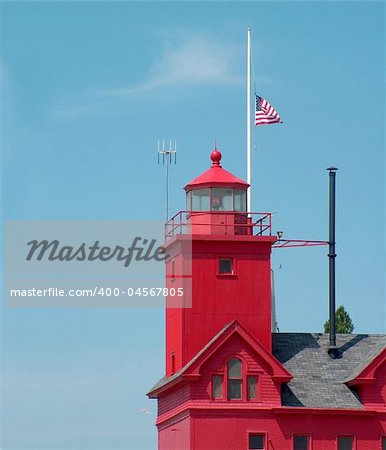 American flag flying at half mast on a lighthouse. Stock Photo - Budget Royalty-Free, Image code: 400-04567805