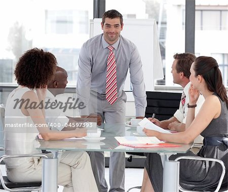 Young Attracitve Businessman giving a presentation Stock Photo - Budget Royalty-Free, Image code: 400-04597393
