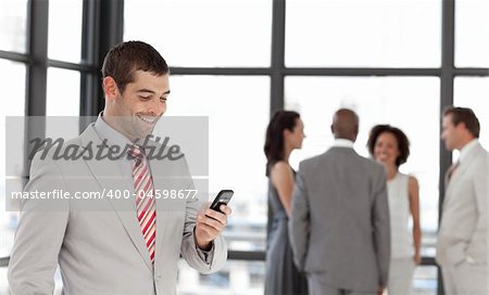 Potrait of a Smiling Businessman sending a text message Stock Photo - Budget Royalty-Free, Image code: 400-04598677