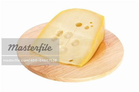 Slice of fresh cheese on wooden dish isolated Stock Photo - Budget Royalty-Free, Image code: 400-04607538