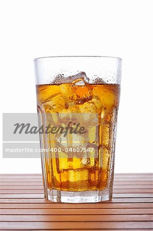 A glass of ice tea on wooden background. Shallow depth of field Stock Photo - Budget Royalty-Free, Image code: 400-04607547