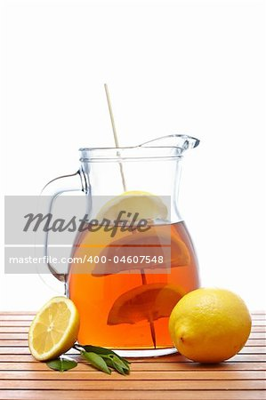 Ice tea pitcher with lemon and icecubes on wooden background Stock Photo - Budget Royalty-Free, Image code: 400-04607548