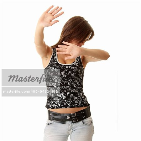 Teen girl frighten, covering her face - abuse crime concept Stock Photo - Budget Royalty-Free, Image code: 400-04624850