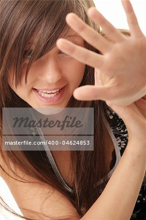 Teen girl frighten, covering her face - abuse crime concept Stock Photo - Budget Royalty-Free, Image code: 400-04624853
