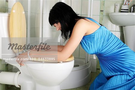 Young caucasian woman in toilet - pregnant,drunk or illness concept Stock Photo - Budget Royalty-Free, Image code: 400-04633885