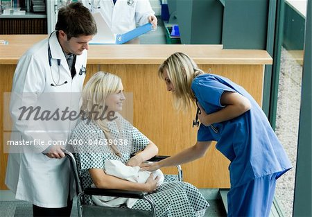 Young doctors looking after a patient in a wheelchair Stock Photo - Budget Royalty-Free, Image code: 400-04639038