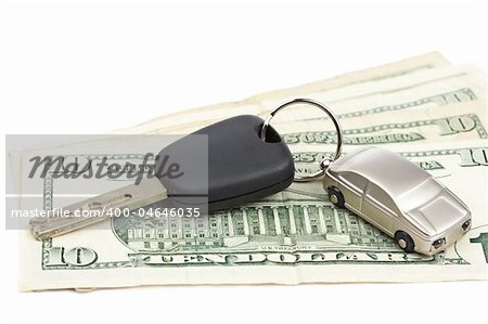 Car key and dollar bills on white background with shallow depth of field Stock Photo - Budget Royalty-Free, Image code: 400-04646035