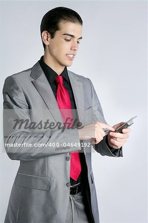 Businessman with gray suit talking cellular phone with suit and red tie Stock Photo - Budget Royalty-Free, Image code: 400-04649192
