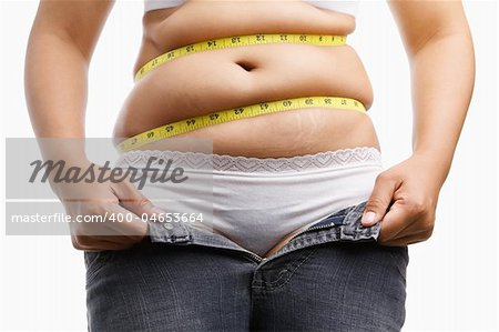 fat woman holding her unzip jeans with measuring tape around her belly, a concept to get a diet Stock Photo - Budget Royalty-Free, Image code: 400-04653664