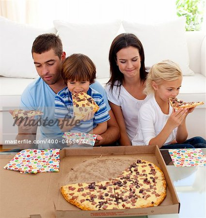 Happy family eating pizza in living-room all together Stock Photo - Budget Royalty-Free, Image code: 400-04654737