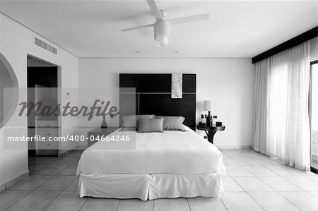 Image of a bedroom suite at a destination hotel resort. Simple and elegant. Portrayed in black and white imagery. Stock Photo - Budget Royalty-Free, Image code: 400-04664246