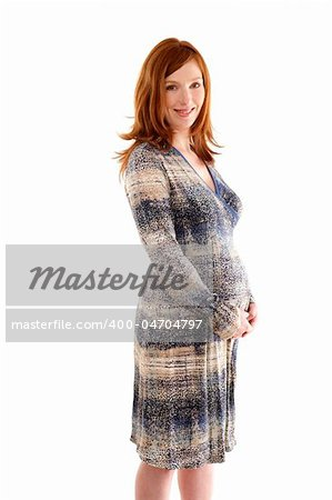Beautiful pregnant redhead woman fashion white background Stock Photo - Budget Royalty-Free, Image code: 400-04704797
