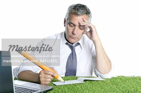 businessman senior sign bank check pensively humor gesture big pencil green grass desk Stock Photo - Budget Royalty-Free, Image code: 400-04712105