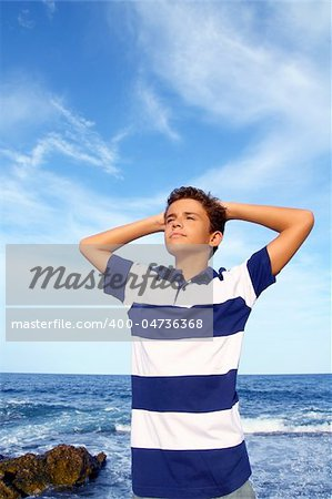 boy teenager hands in head relaxed in blue ocean sea beach summer vacation Stock Photo - Budget Royalty-Free, Image code: 400-04736368
