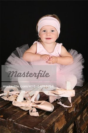 Baby ballerina sitting on an antique trunk Stock Photo - Budget Royalty-Free, Image code: 400-04740756