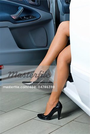 Young lady get out of the car Stock Photo - Budget Royalty-Free, Image code: 400-04746398