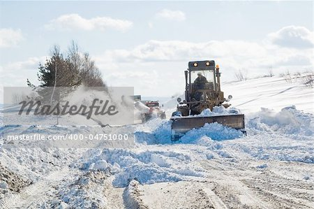 Snowplow removing snow from intercity road from snow blizzard Stock Photo - Budget Royalty-Free, Image code: 400-04751000