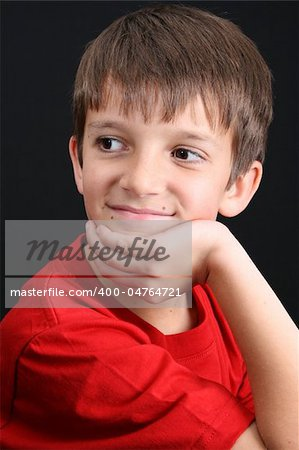 Young boy with big eyes in casual attire Stock Photo - Budget Royalty-Free, Image code: 400-04764721