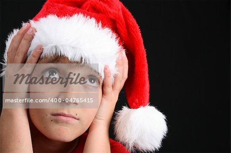 Young boy wearing a red shirt and christmas hat Stock Photo - Budget Royalty-Free, Image code: 400-04765415