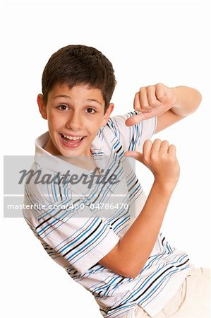 A happy handsome boy is pointing at himself while dancing; isolated on the white background Stock Photo - Budget Royalty-Free, Image code: 400-04786470