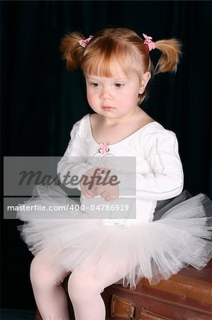 Little ballet toddler wearing a white tutu Stock Photo - Budget Royalty-Free, Image code: 400-04786919