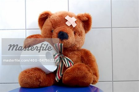 toy teddy bear with paper in the bathroom on toilet Stock Photo - Budget Royalty-Free, Image code: 400-04796222