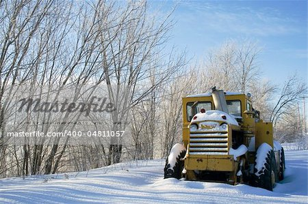 Tractor covered with snow sits idle Stock Photo - Budget Royalty-Free, Image code: 400-04811057