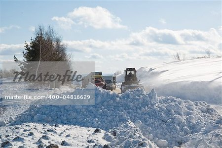 Snowplow removing snow from intercity road from snow blizzard Stock Photo - Budget Royalty-Free, Image code: 400-04816629