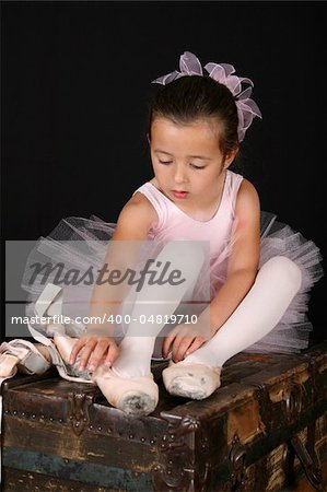 Cute little ballet girl trying on pointe shoes Stock Photo - Budget Royalty-Free, Image code: 400-04819710