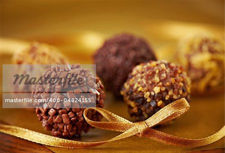 various types of chocolate truffles and yellow ribbon Stock Photo - Budget Royalty-Free, Image code: 400-04824155