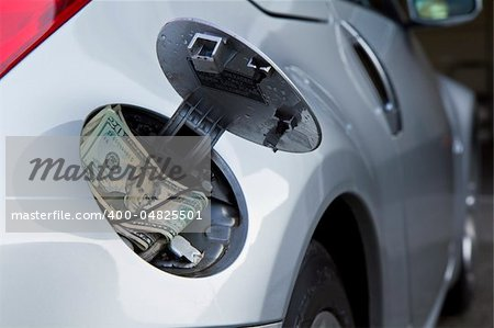 Tough times with raising fuel prices - especially a gas guzzler that just eats your hard, earn money Stock Photo - Budget Royalty-Free, Image code: 400-04825501
