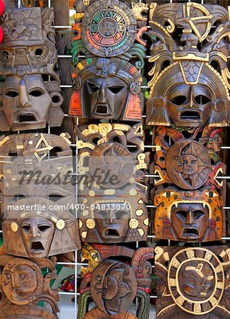 aztec mayan wooden Mexican indian mask handcrafts in rows Stock Photo - Budget Royalty-Free, Image code: 400-04833070