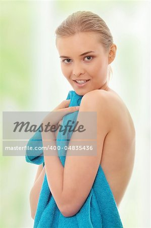 Portrait of the beautiful naked woman covering her body with blue towel Stock Photo - Budget Royalty-Free, Image code: 400-04835436