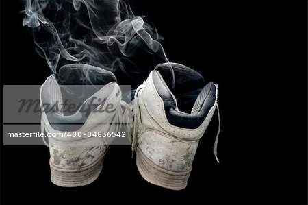 dirty old pair of sneakers on a black background Stock Photo - Budget Royalty-Free, Image code: 400-04836542