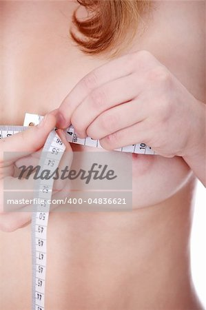 Beautiful, young woman measuring her breast Stock Photo - Budget Royalty-Free, Image code: 400-04836621