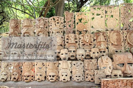 Mayan wood mask rows Mexico handcraft faces indian culture Stock Photo - Budget Royalty-Free, Image code: 400-04837561