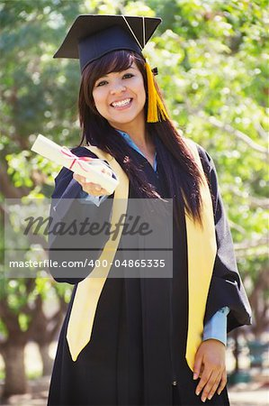 Stock image of happy female graduate, outdoor setting Stock Photo - Budget Royalty-Free, Image code: 400-04865335