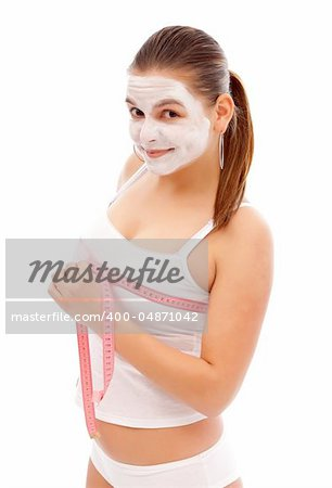 Young woman with a beauty mask measures her breast with a measuring tape Stock Photo - Budget Royalty-Free, Image code: 400-04871042