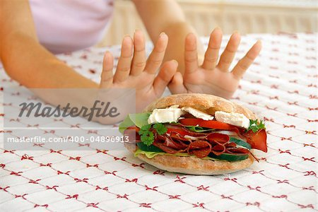 female hands refusing big meat sandwich with ham and cheese Stock Photo - Budget Royalty-Free, Image code: 400-04896913