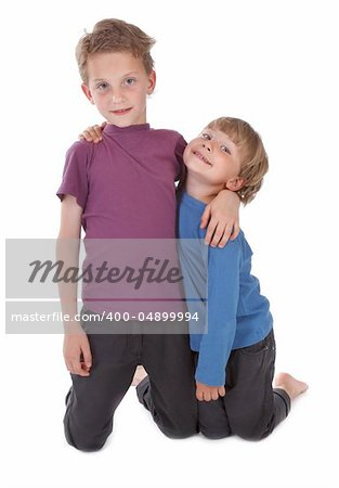 two happy brothers against white background Stock Photo - Budget Royalty-Free, Image code: 400-04899994