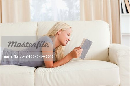 Serene woman reading a book in her living room